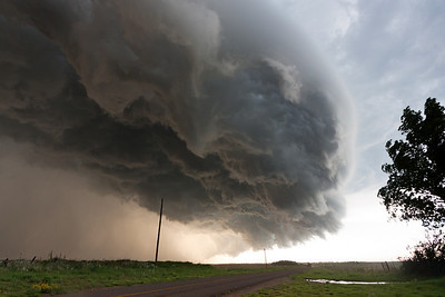 A frightening shelf cloud surges ahead of an outflow-dominant thunderstorm complex near Quail, TX, on May 12, 2009. This shelf cloud was advancing at over 60 mph for a time.
