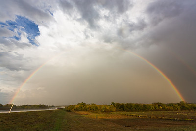 Perfect rainbow behind a line of thunderstorms on I-44 near Amber, OK, on October 13, 2012.