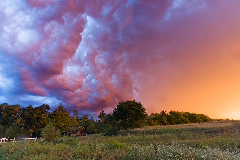 "Brilliant colors illuminate the ""whale's mouth"" of a thunderstorm over Norman, OK, at sunrise on May 30, 2012."