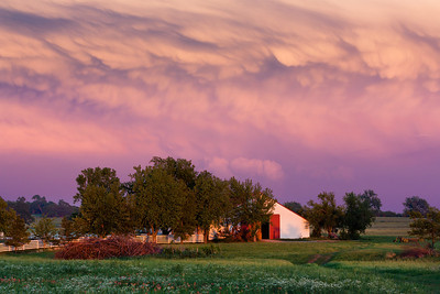 A mammatus-filled sunset behind a departing thunderstorm near Lexington, OK, on May 12, 2011.