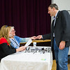 New Hampshire Governor Chris Sununu has his ID checked to recieve the ballot at the Newfields Town Hall in the 2018 election on Tuesday 11-6-2018, Newfields NH.  [Matt Parker/Seacoastonline]