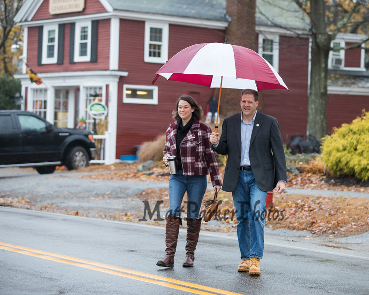 New Hampshire Governor Chris Sununu and his wife Valerie cross the street in front of the Newfields Country Store on their walk to cast their vote at the Newfields Town Hall in the 2018 election on Tuesday 11-6-2018, Newfields NH.  [Matt Parker/Seacoastonline]