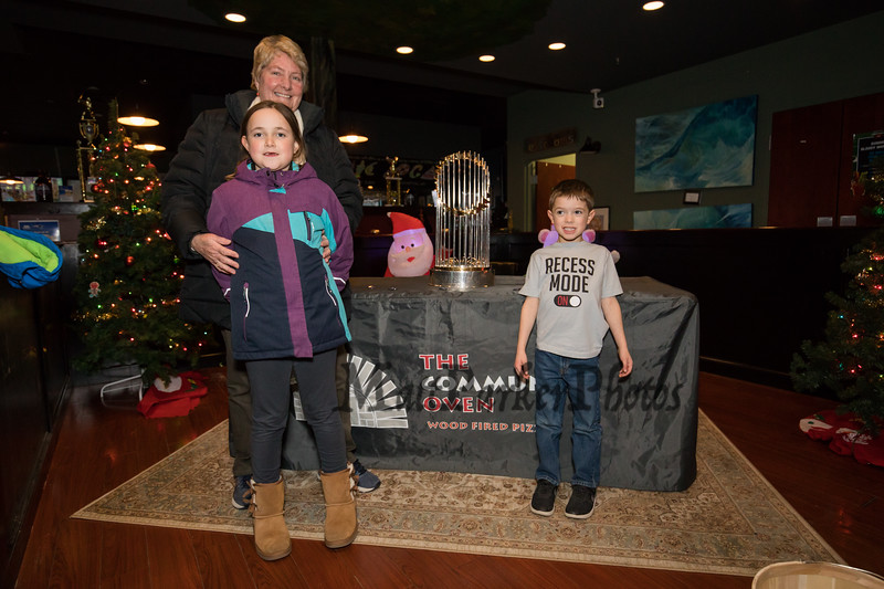 Hampton residents Andrea Shepard with her grandchildren Myles Babineau (kg) and sister Makenna (3rd grade) pose for a photo next to the 2018 Boston Red Sox World Championship Trophy sponsored by The Community Oven of Hampton in conjunction with Amy's Treat a Dover based 501©3 charity to raise money for cancer patients in the Southern NH and Eastern Maine areas on Thursday 12-6-2018 @ Hampton, NH.  [Matt Parker/Seacoastonline]