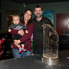 Community Oven owners Mary Griffin with her grandson 1 year old Ronan and Shane Pine pose for a photo next to the 2018 Boston Red Sox World Championship Trophy sponsored by The Community Oven of Hampton in conjunction with Amy's Treat a Dover based 501©3 charity to raise money for cancer patients in the Southern NH and Eastern Maine areas on Thursday 12-6-2018 @ Hampton, NH.  [Matt Parker/Seacoastonline]