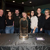 Community Oven employees pose with the 2018 Boston Red Sox World Championship Trophy (L to R) Eric Burns, Danielle Wilkins, Shane Pine, Amanda Villandry, Jodie Goucher, Amanda Morecroft and Stacey Retherford at a fundraising event sponsored by The Community Oven of Hampton in conjunction with Amy's Treat a Dover based 501©3 charity to raise money for cancer patients in the Southern NH and Eastern Maine areas on Thursday 12-6-2018 @ Hampton, NH.  [Matt Parker/Seacoastonline]