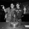 Hampton residents Kathy Hartnett and Joey Gregory showing their team spirit next to the 2018 Boston Red Sox World Championship Trophy sponsored by The Community Oven of Hampton in conjunction with Amy's Treat a Dover based 501©3 charity to raise money for cancer patients in the Southern NH and Eastern Maine areas on Thursday 12-6-2018 @ Hampton, NH.  [Matt Parker/Seacoastonline]