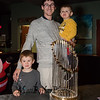 Brandon Mattison with his sons Carter (4 yr) and Easton (2 yr) pose for a photo with the 2018 Boston Red Sox World Championship Trophy sponsored by The Community Oven of Hampton in conjunction with Amy's Treat a Dover based 501©3 charity to raise money for cancer patients in the Southern NH and Eastern Maine areas on Thursday 12-6-2018 @ Hampton, NH.  [Matt Parker/Seacoastonline]
