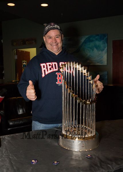 """Chris Menz of Hampton Beach gives, """"two thumbs up"""" while posing for a photo next to the 2018 Boston Red Sox World Championship Trophy sponsored by The Community Oven of Hampton in conjunction with Amy's Treat a Dover based 501©3 charity to raise money for cancer patients in the Southern NH and Eastern Maine areas on Thursday 12-6-2018 @ Hampton, NH.  [Matt Parker/Seacoastonline]"""