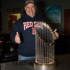 "Chris Menz of Hampton Beach gives, ""two thumbs up"" while posing for a photo next to the 2018 Boston Red Sox World Championship Trophy sponsored by The Community Oven of Hampton in conjunction with Amy's Treat a Dover based 501©3 charity to raise money for cancer patients in the Southern NH and Eastern Maine areas on Thursday 12-6-2018 @ Hampton, NH.  [Matt Parker/Seacoastonline]"
