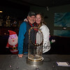 Randy Currier and Nancy Andrew both of Hampton pose for a photo next to the 2018 Boston Red Sox World Championship Trophy sponsored by The Community Oven of Hampton in conjunction with Amy's Treat a Dover based 501©3 charity to raise money for cancer patients in the Southern NH and Eastern Maine areas on Thursday 12-6-2018 @ Hampton, NH.  [Matt Parker/Seacoastonline]