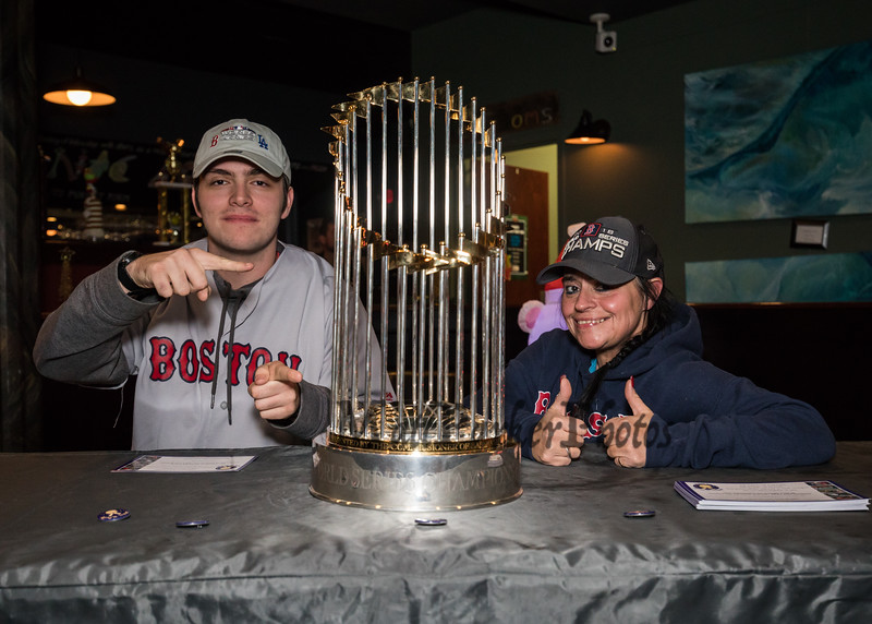 Sean and Gina McGinness made the trip up from Seabrook to see and admire the 2018 Boston Red Sox World Championship Trophy sponsored by The Community Oven of Hampton in conjunction with Amy's Treat a Dover based 501©3 charity to raise money for cancer patients in the Southern NH and Eastern Maine areas on Thursday 12-6-2018 @ Hampton, NH.  [Matt Parker/Seacoastonline]