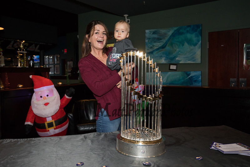 Hampton residents Mary Griffin with her 1 year old grandson Ronan pose for a photo next to the 2018 Boston Red Sox World Championship Trophy sponsored by The Community Oven of Hampton in conjunction with Amy's Treat a Dover based 501©3 charity to raise money for cancer patients in the Southern NH and Eastern Maine areas on Thursday 12-6-2018 @ Hampton, NH.  [Matt Parker/Seacoastonline]