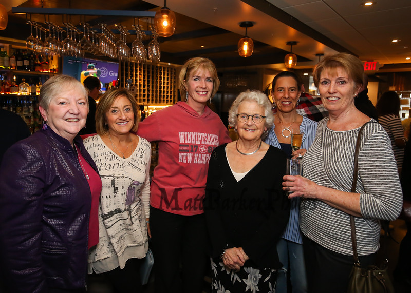 Ellie Whitney poses for a photo with some of her many co-worker/friends that came to wish her well during her retirement (L to R) Jane Kiarnan, Ann Cummings, Donna Reynolds, Ellie, Kitty Malloy and Pam Clark at the Tinos Greek Kitchen/Galley Hatch Restaurant on Monday, 4-30-2018, Hampton, NH.  Matt Parker Photos