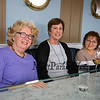 Friends of Ellie Whitney (L to R) Katie McNamara, Margaret Chadwick and Cindy Meade came to celebrate Ellie Whitney's retirement as they all worked with Ellie when they were in their 20's as they pose for a photo on the upper deck of Tinos Greek Kitchen on Monday, 4-30-2018, Hampton, NH.  Matt Parker Photos