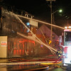 Firehoses spraying water onto fire late Thursday night 3 alarm fire at the SeaWalk Apartments and Laundry on Ashworth Ave, Hampton Beach, NH on 4-5-2018.  Matt Parker Photos