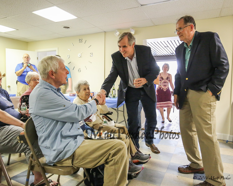 U.S. Senator Jeff Merkley of Oregon introduces himself to Gary and Lenore Patton of Hampton with Mark Vallone, Treasurer of the Rockingham County Democrats on Sunday, May 20, 2018 at the Rockingham County Democrats office in Exeter, NH.  [Matt Parker/Seacoatonline]
