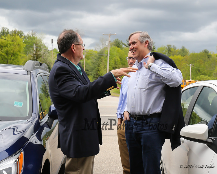 Mark Vallone, Treasurer of the Rockingham County Democrats, greets Oregon's US Senator Jeff Merkley to their office in Exeter on Sunday Sunday, May 20, 2018 [Matt Parker/Seacoatonline]