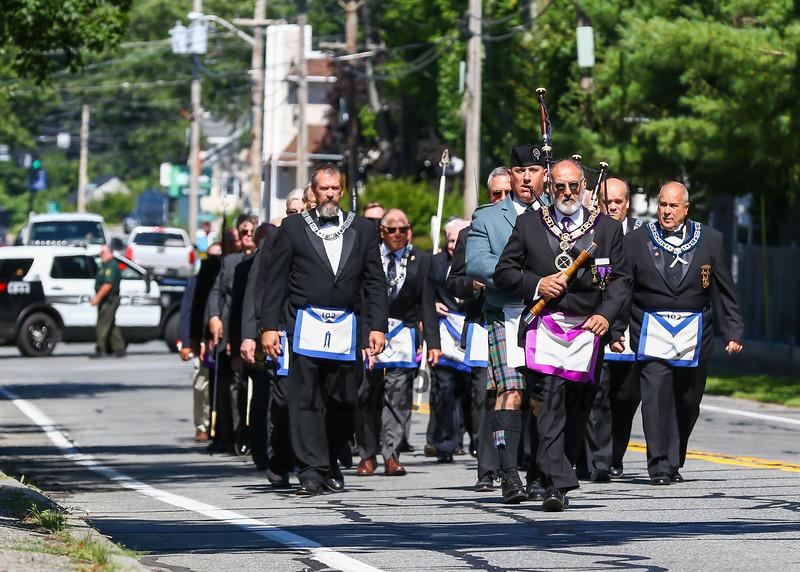 Members of the Masonic Lodge of Masons march down High Street on their way to the Hampton Academy Cornerstone Dedication on Saturday 7-21-2018, Hampton, NH.  [Matt Parker/Seacoastonline]
