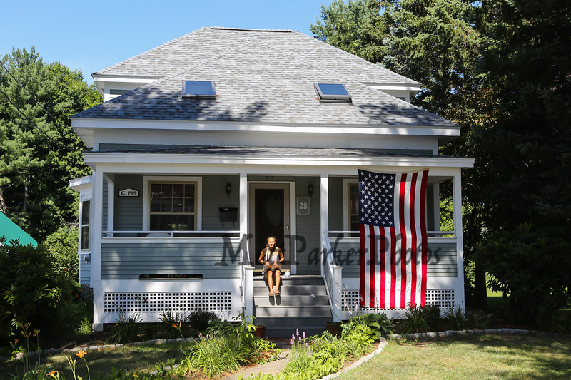 Lisa on the porch with flag on Saturday 7-21-2018, Hampton, NH.  Matt Parker Photos