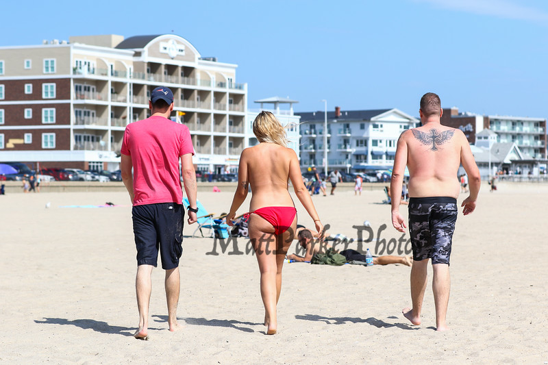"""22 year old Cheyenne Olson of Vermont participated in the Hampton Beach """"Go Topless Day"""" seen here walking with her friends Adrian and Ryan Brower also of Vermont on Sunday 8-26-2018 at Hampton Beach, NH.  Matt Parker Photos"""