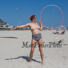 """25 year old Daisy Richardson of Boston Mass a strong support of the """"Go Topless Day"""" at Hampton beach shows off her special bikin top while using here hula hoop on Sunday 8-26-2018 at Hampton Beach, NH.  Matt Parker Photos"""