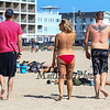 "22 year old Cheyenne Olson of Vermont participated in the Hampton Beach ""Go Topless Day"" seen here walking with her friends Adrian and Ryan Brower also of Vermont on Sunday 8-26-2018 at Hampton Beach, NH.  [Matt Parker/Seacoastonline]"