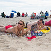 "Enjoying the sand, snu and warm weather 22 year old Cheyenne Olson of Vermont participated in the Hampton Beach ""Go Topless Day"" with her friends Adrian and Ryan Brower also of Vermont on Sunday 8-26-2018 at Hampton Beach, NH.  Matt Parker Photos"