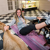 """Goat Yoga"" instructor Jordan Taylor performs a leg lift while goats ""Sylvia"" (L) and ""Tallie"" (R) provide balance support in the yoga room at Legacy Lane Farm on Tuesday 11-5-2019 @ Stratham, NH.  [Matt Parker/Seacoastonline]"