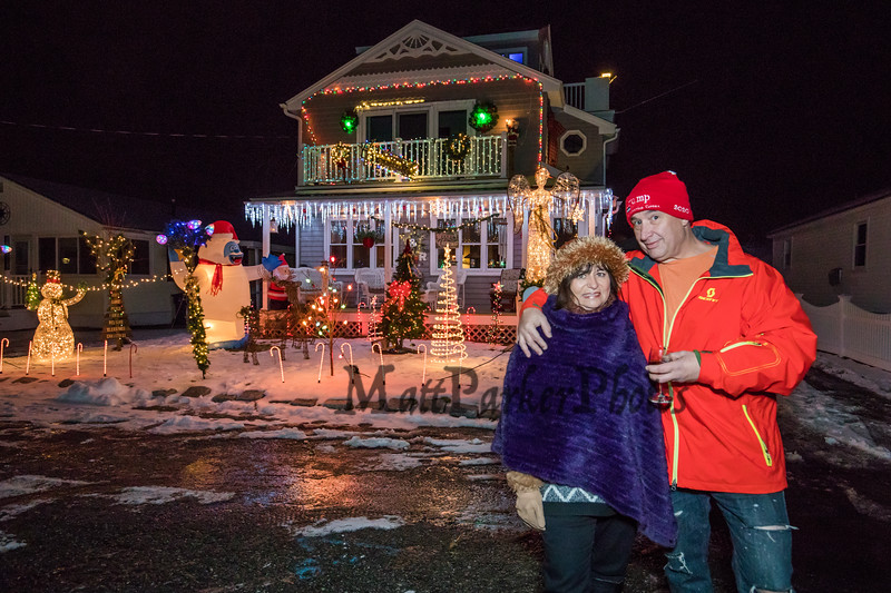 Randy Durant and Leila Harrington set up a Christmas lights display this winter in honor of Harrington's late parents, who died last month and once owned their home on Susan Lane on Wednesday 12-18-2019 at Hampton Beach.  Matt Parker Photos