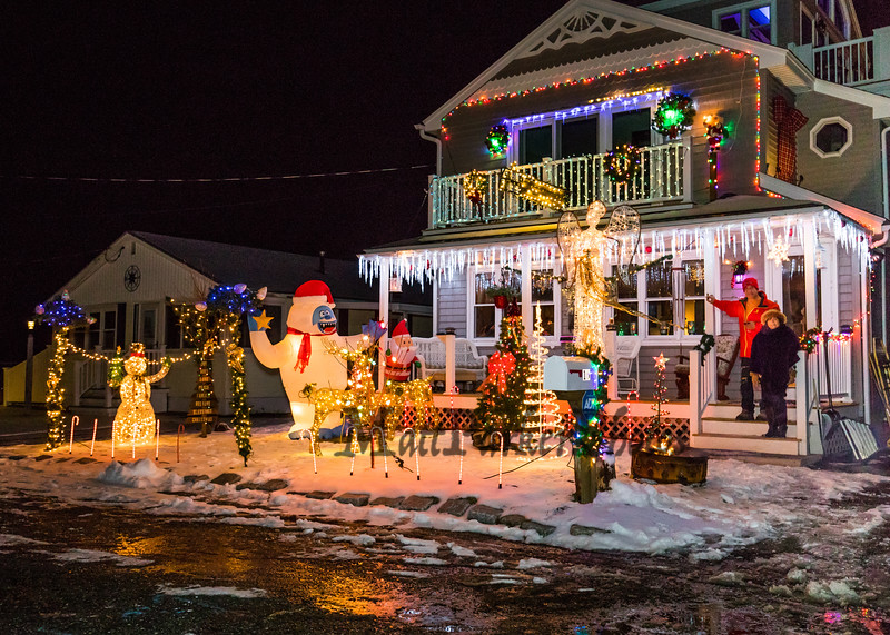 Randy Durant and Leila Harrington set up a Christmas lights display this winter in honor of Harrington's late parents, who died last month and once owned their home on Susan Lane on Wednesday 12-18-2019 at Hampton Beach.  [Matt Parker/Seacoastonline]