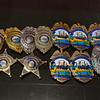 A collection of police badges-shields that were worn over the years by the Vetter-Linchey policemen on Monday 5-13-2019 @ Hampton, NH.  Matt Parker Photos
