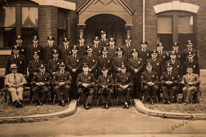 "Old Station photo with Wayne Vetter's greatgrandfather William Linchey (front row center) and father Charles F. Vetter (2nd row 4th from left) celebrating 5 generations of Vetter, Linchey police law enforcement on Monday 5-13-2019 @ Hampton, NH.  ""Philip's photo"", [Matt Parker/Seacoastonline]"