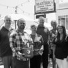 (L to R) Tom McGuirk of McGuirk's Restaurant, Tom Hunt Junior, Jessica Dolmat of Ocean Wok Restaurant, Nate Denio and EMS Officer of the Hampton FD, Kristen Gallant of CF Medical and Julie Hunt, The Hunt's donated an AED Defibrillator to McGuirk's and Ocean Wok restaurants after their father Tom Hunt died of cardiac arrest, photo taken on Friday 8-2-2019, Hampton Beach, NH.  [Matt Parker/Seacoastonline]