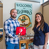 Tom Hunt Junior and his sister Julie sand inside the reception area at McGuirk's Restaurant where the Philips AED Defibrillator will be located.  The Hunt's mom Aideen donated an AED Defibrillator to both McGuirk's and Ocean Wok restaurants after her husband Tom Hunt died of cardiac arrest.  The donation was made with the intent having this equipment available for someone else with a similar emergency, photo taken on Friday 8-2-2019, Hampton Beach, NH.  [Matt Parker/Seacoastonline]