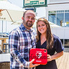 Tom Hunt Junior and his sister Julie sand outside the new seating area at McGuirk's Restaurant.  The Hunt's mom Aideen donated an AED Defibrillator to both McGuirk's and Ocean Wok restaurants after her husband Tom Hunt died of cardiac arrest.  The donation was made with the intent having this equipment available for someone else with a similar emergency, photo taken on Friday 8-2-2019, Hampton Beach, NH.  [Matt Parker/Seacoastonline]