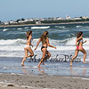 Three girls running into the surf on Hampton Beach (L to R) Daniela Dinitto, Brooke Brown and Deanna Dinitto of Methuen and Melrose Mass on on a cool, windy and sunny Sunday 8-25-2019, Hampton Beach, NH.  [Matt Parker/Seacoastonline]