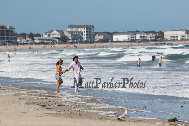 A couple walking on the beach on a cool, windy and sunny Sunday 8-25-2019, Hampton Beach, NH.  [Matt Parker/Seacoastonline]