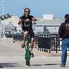 Robert LeBlanc of Holyoke Mass riding his tall green custom bicycle on on a cool, windy and sunny Sunday 8-25-2019, Hampton Beach, NH.  Matt Parker Photos