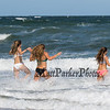Three girls running into the surf on Hampton Beach (L to R) Daniela Dinitto, Brooke Brown and Deanna Dinitto of Methuen and Melrose Mass on on a cool, windy and sunny Sunday 8-25-2019, Hampton Beach, NH.  Matt Parker Photos