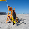 Hampton Beach Rookie Lifeguard Elisa Delgado keeping a watchful eye on swimmers in the heavy surf on a cool, windy and sunny Sunday 8-25-2019, Hampton Beach, NH.  [Matt Parker/Seacoastonline]