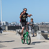 Robert LeBlanc of Holyoke Mass riding his tall green custom bicycle on on a cool, windy and sunny Sunday 8-25-2019, Hampton Beach, NH.  [Matt Parker/Seacoastonline]