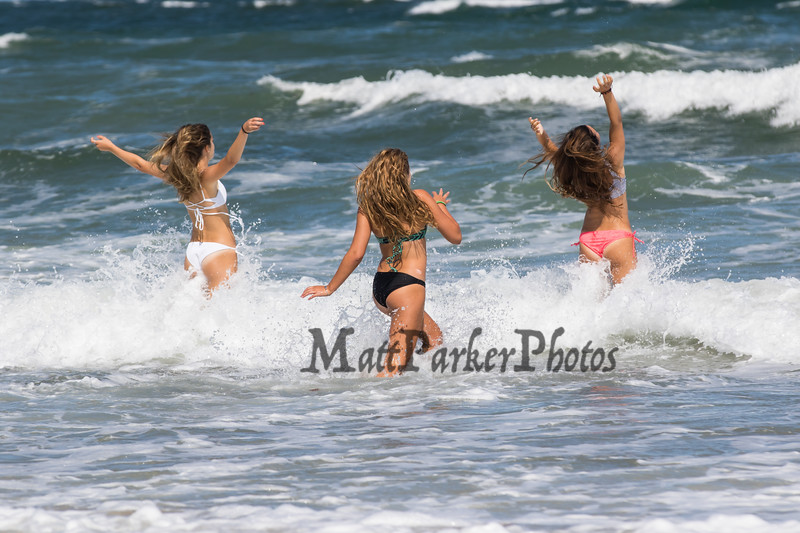 Three girls heading into the surf on Hampton Beach (L to R) Daniela Dinitto, Brooke Brown and Deanna Dinitto of Methuen and Melrose Mass on on a cool, windy and sunny Sunday 8-25-2019, Hampton Beach, NH.  [Matt Parker/Seacoastonline]