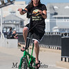 Robert LeBlanc of Holyoke Mass riding his tall green custom bicycle on on a cool, windy and sunny Sunday 8-25-2019, Hampton Beach, NH.  Matt Parker Photos