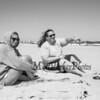 Lauren McDough and Erin Baker of Massachusetts came for the sun but spent the better part of the day trying to keep the blowing sand off their blankets on a cool, windy and sunny Sunday 8-25-2019, Hampton Beach, NH.  Matt Parker Photos