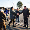Presidential hopeful Democrat Tulsi Gabbard (L) shakes hands with Amanda and Ned Kittredge of Hampton before heading in to Cinnamon Rainbows Surf Co. to suit up in a wetsuit for a morning surfing outing on New Years Day at Hampton's North Beach on January 1st 2020 Hampton, New Hampshire.  [Matt Parker/Seacoastonline]