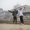 "With a team building leap into the air in front of the Hampton Beach State Park Lifeguard Station, 2019 graduates Emmie Daswani of WHS and Garret Roberts of EHS pose for photos at Hampton Beach where they will end their planned 120 mile journey from NH's Highest Mt. Washington to lowest, Hampton Beach,  ""The Highs & Lows"" as they raise money to support Mental Health aflictions through their funraiser, ""The Concept Project"" on Tuesday 12-1-2020, Hampton Beach, NH.  Matt Parker Photos"