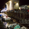 Fans greet Santa as he arrives by the Lady Ella fishing boat as he embarks at the dock of the Yankee Fishermen's Cooperative, 2nd Annual Lobster trap Tree Lighting and visit by santa on Sunday 12-13-2020 @ Seabrook Beach, NH.  Matt Parker Photos