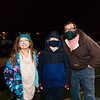 Joesph Carpino with his 4th grad son Joey and 5th grade daughter Olivia pose for a photo while waiting for santa to arrive by fishing boat at the Fishermen's Cooperative, 2nd Annual Lobster trap Tree Lighting and visit by santa on Sunday 12-13-2020 @ Seabrook Beach, NH.  Matt Parker Photos