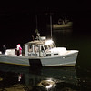 Santa arrives by the Lady Ella fishing boat as he embarks at the dock of the Yankee Fishermen's Cooperative, 2nd Annual Lobster trap Tree Lighting and visit by santa on Sunday 12-13-2020 @ Seabrook Beach, NH.  Matt Parker Photos