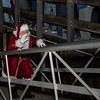 Santa makes his way up the gangplank at the Yankee Fishermen's Cooperative, 2nd Annual Lobster trap Tree Lighting and visit by santa on Sunday 12-13-2020 @ Seabrook Beach, NH.  Matt Parker Photos